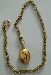 joli pendentif reliquaire en or avec châtelaine en fix