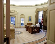 President Barack Obama talks on the phone in the Oval Office Photo Print