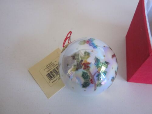 Inside Pained glass Christmas ornament in red box
