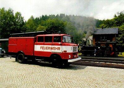 DDR-Oldtimer Feuerwehr IFA W50 LA LF 16 und Dampflok 99 542 Ansichtskarte