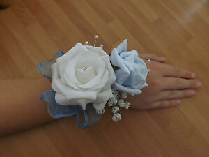 Wedding-flowers-bridesmaids-wrist-corsage-white-baby-blue-roses-diamante-pearls