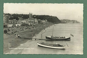 C1950-039-S-RP-POSTCARD-TEIGNMOUTH-BEACH-LOOKING-EAST-BUSY-SCENE-2-BOATS-AT-SHORE