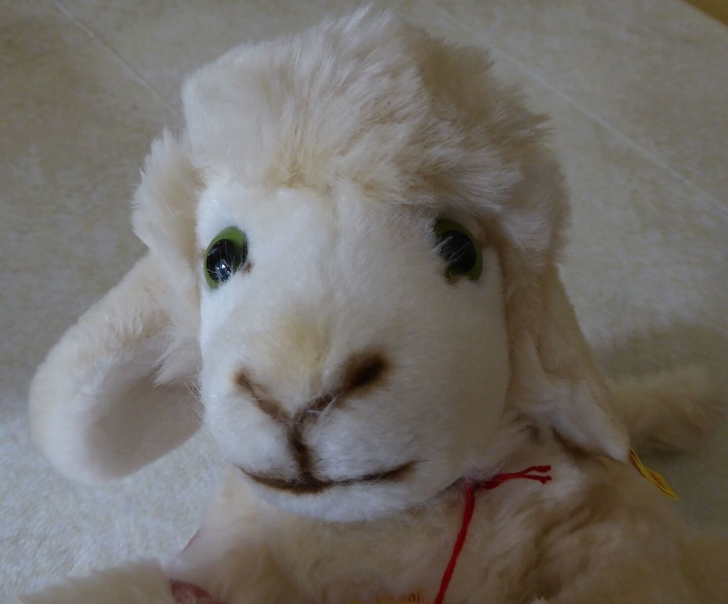 Steiff Cosy Lamby 15 , Lying 5473 40 with tags and button in ear