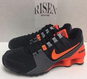 meet fda9d ab805 black and orange nike shox