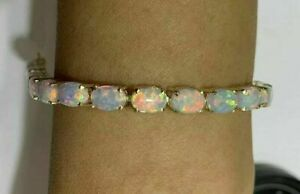 8Ct-Oval-Cut-Fire-Opal-7-25-Inches-Tennis-Bracelet-14k-Yellow-Gold-Finish
