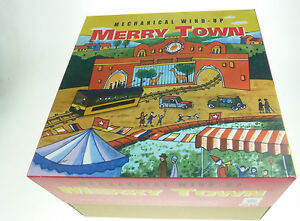 MECHANICAL-WIND-UP-TOY-MERRY-TOWN-HAHA-TOY-COLLECTORS-CLOCKWORK-TIN-TOY