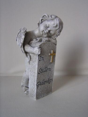 Lanterne Ange debout à côté un sort Pierre ange