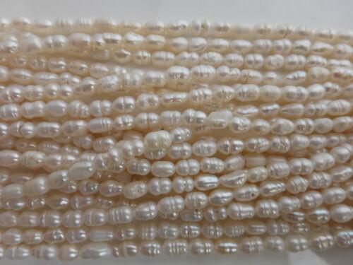 "14/"" strand env. 49 perles Ivory crème d/'eau douce riz perles 6mm x 4mm"