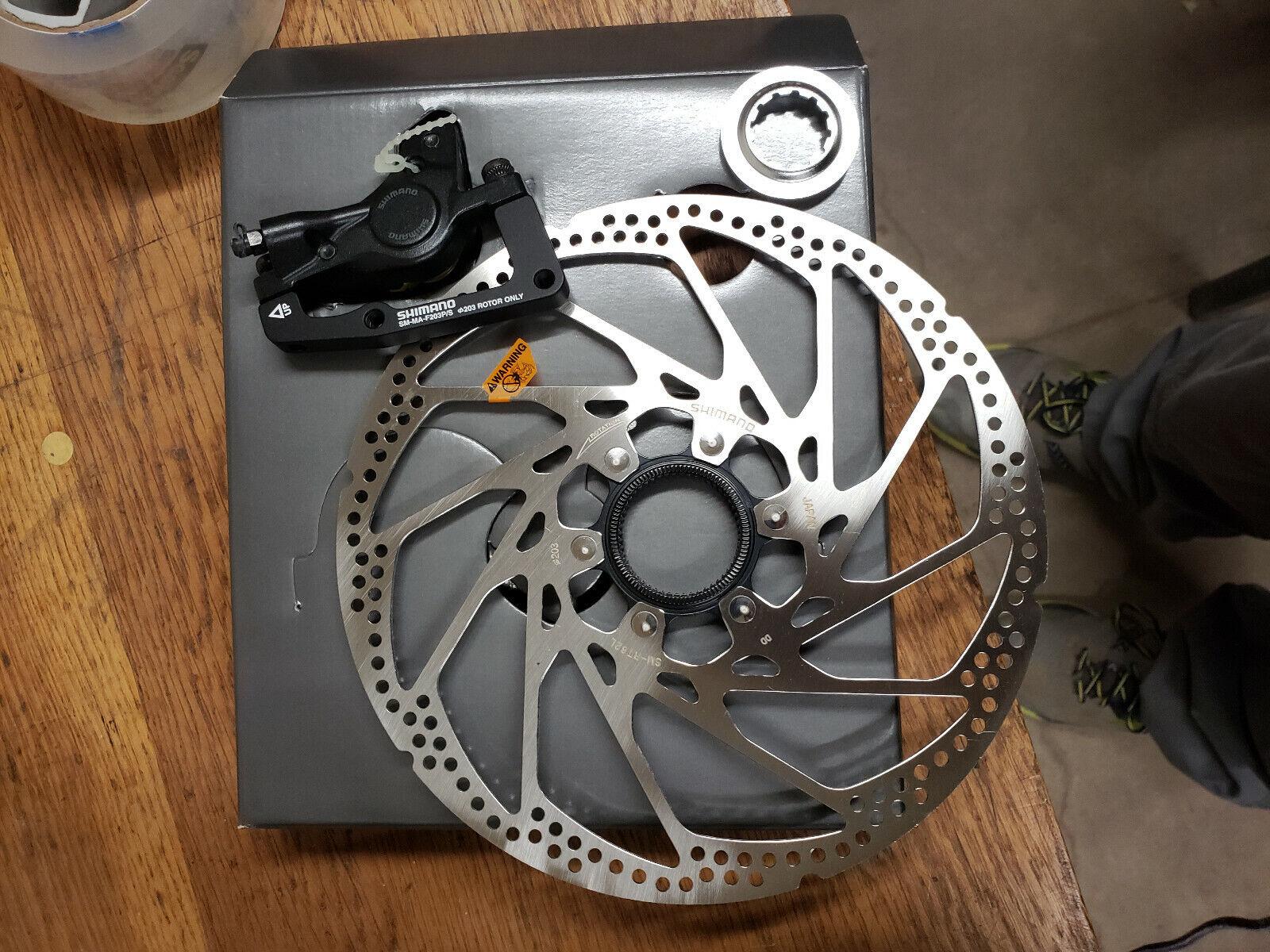 Hone 203 brake disc with caliper and bracket and brake pads SKU 689228078604