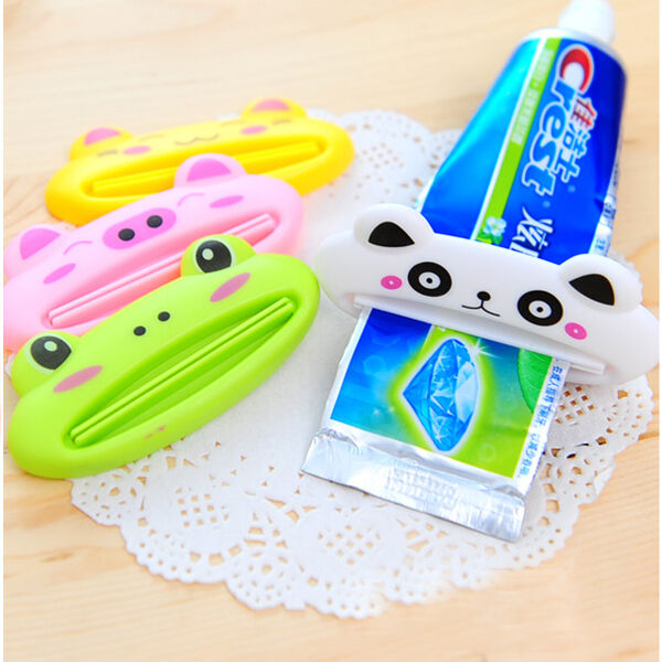 NEW BATHROOM HOME TUBE ROLLING HOLDER SQUEEZER EASY CARTOON TOOTHPASTE DISPENSER