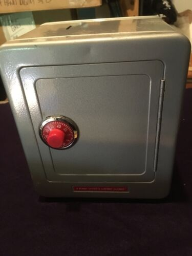 """A PENNY SAVED"" METAL COMBINATION SAFE BANK with ALARM"