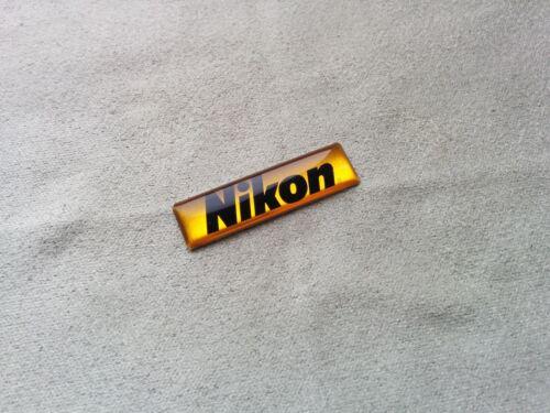 Logotipo de Nikon Pegatina semicirculares de color amarillo-negro