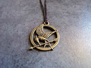 New bronze hunger games mockingjay pendant charm necklace brown cord image is loading new bronze hunger games mockingjay pendant charm necklace aloadofball Images