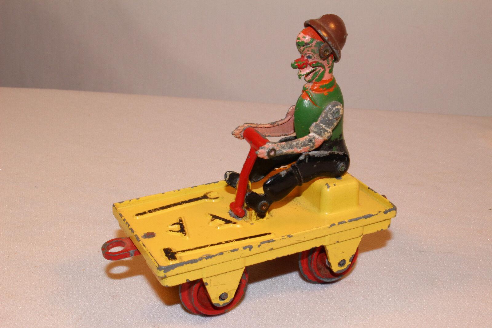 1940's D.C.M.T. Die Cast Clown on Train Pump Car, Made in England, Original