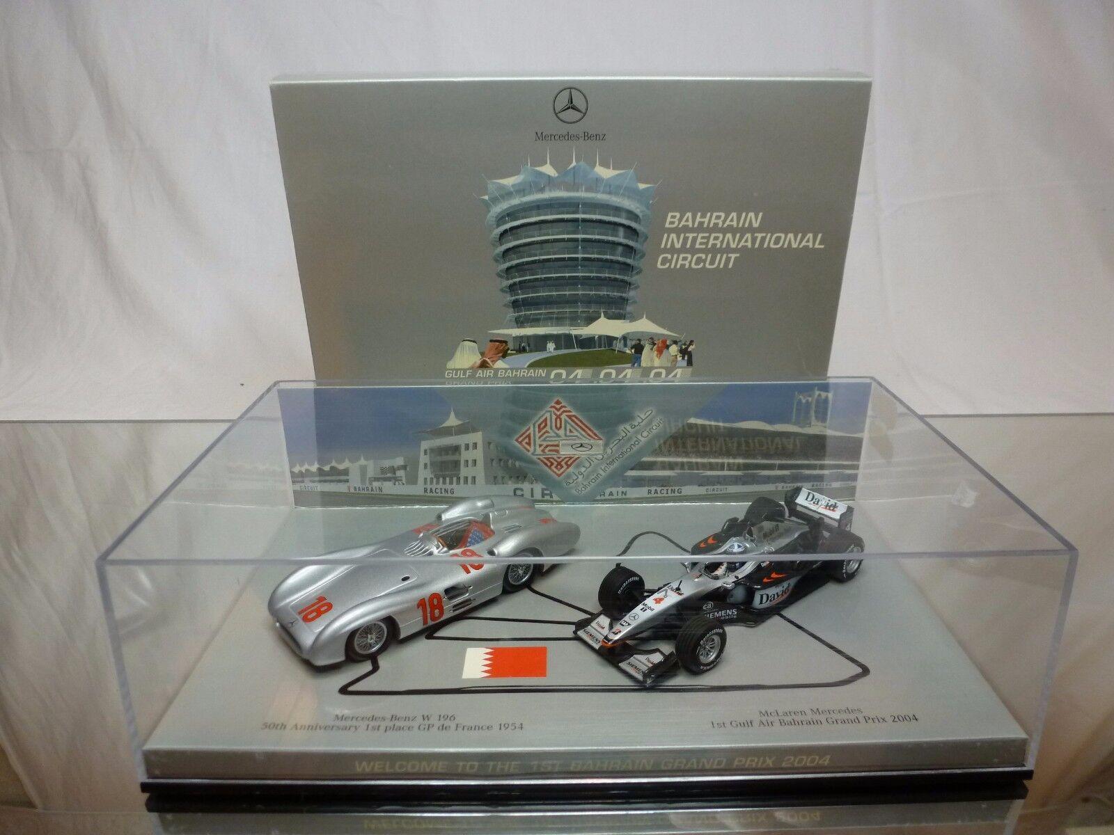 MINICHAMPS - MERCEDES BENZ W 196 + McLAREN F1 2004 1st BAHRAIN 04.04.04 - RARE