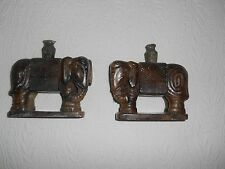 Antique hand carved green and brown Jade elephant bookends.Beautifully done