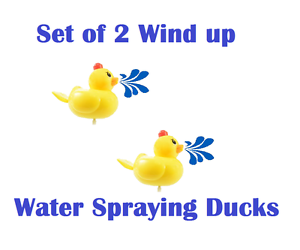 2PC Swimming wind-up Duck water Spraying Bath Ducks Wind And Waggle Water Swim