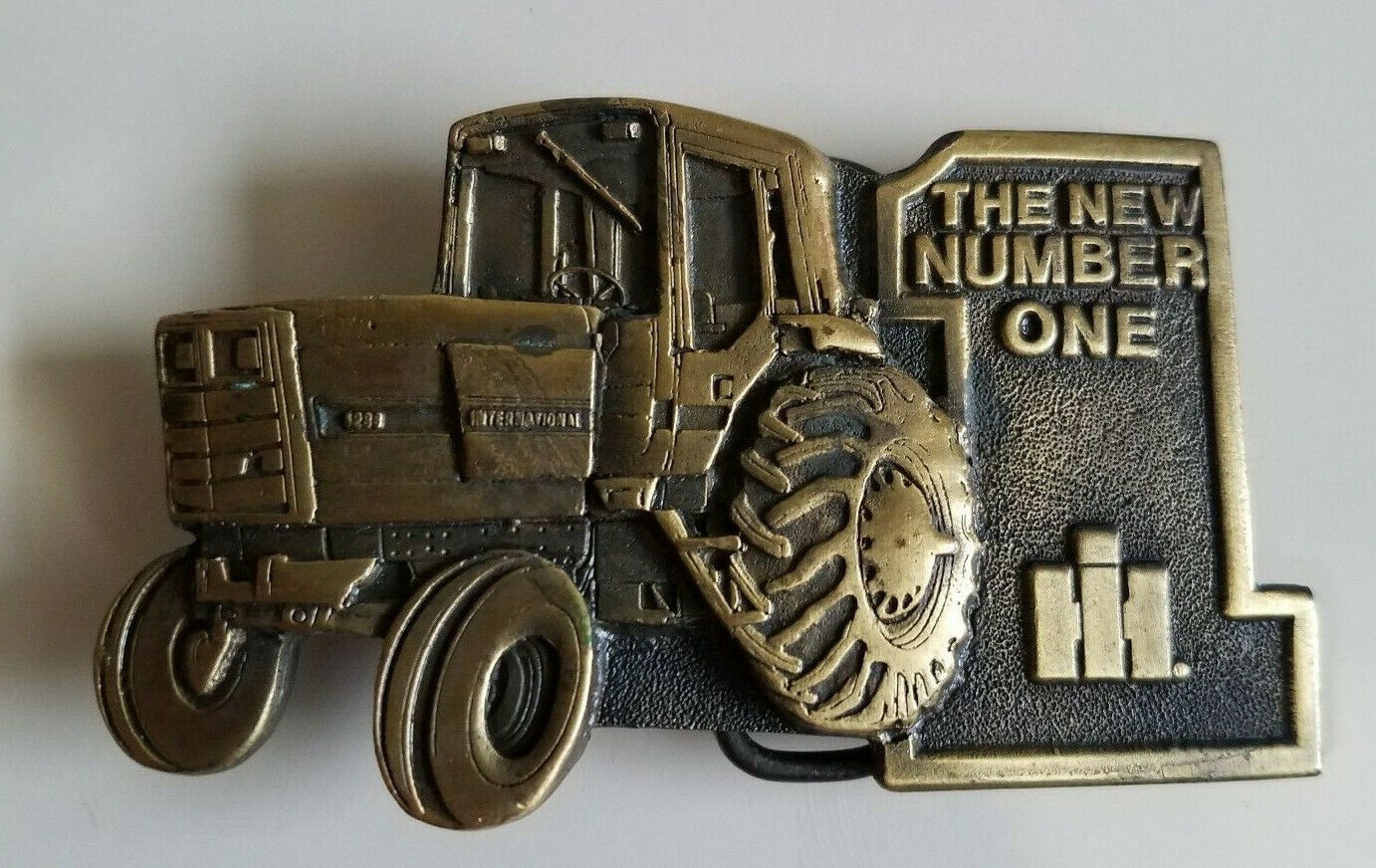 International The New Number One 1 5288 Tractor Brass Spec Cast Inc Belt Buckle