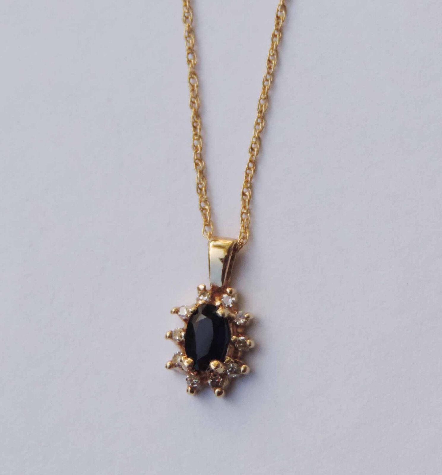 Ladies Oval bluee Sapphire Gemstone Pendant w  10 Dia. Accents - 10k Yellow gold
