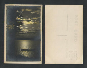 1910s-MAN-IN-CANOE-ON-WATER-AT-NIGHT-MOON-RPPC-REAL-PICTURE-POSTCARD