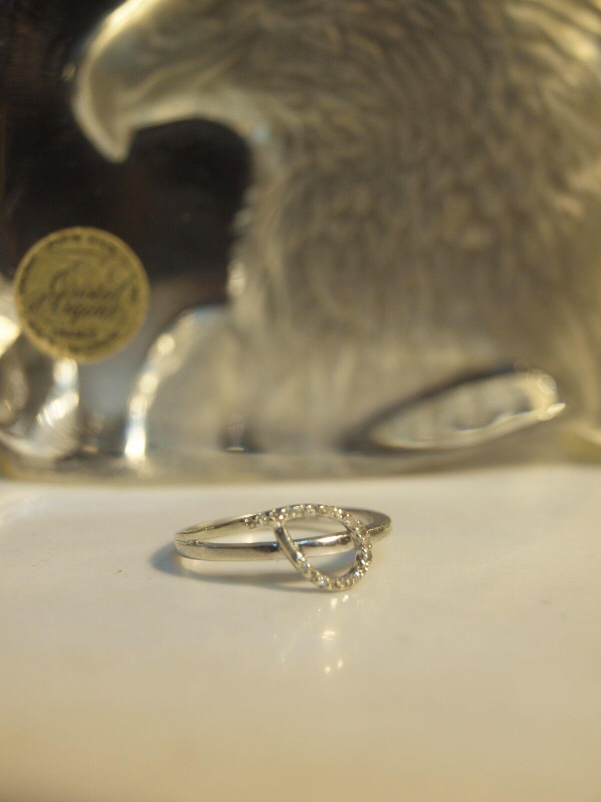 10K WHITE gold LADIES TWIRL DIAMOND RING SIZE   O   (0.19 CARAT DIAMONDS) 10K