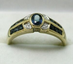 Lovely 9 carat Gold Blue Topaz And Diamond Dress Ring Size Q
