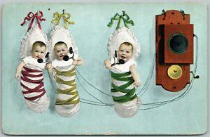 MULTIPLE-BABIES-PHONE-TALK-ANTIQUE-POSTCARD-TELEPHONE-PIONEERS-OF-AMERICA