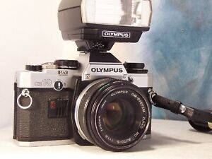 olympus OM-10 avec 50mm et flash plus les modes d'emploi