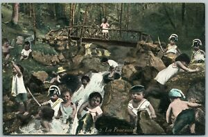 MULTIPLE-BABIES-IN-THE-FOREST-ANTIQUE-POSTCARD