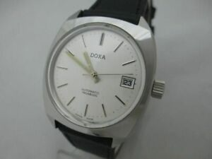 NOS NEW SWISS MADE AUTOMATIC ANTIMAGNETIC MEN'S DOXA WATCH 1960'S WITH DATE