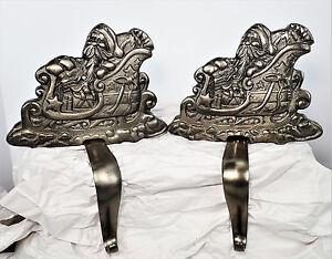 2 Cast Metal Heavy Stocking Mantle Holders Santa Sleigh Holiday Christmas 2002