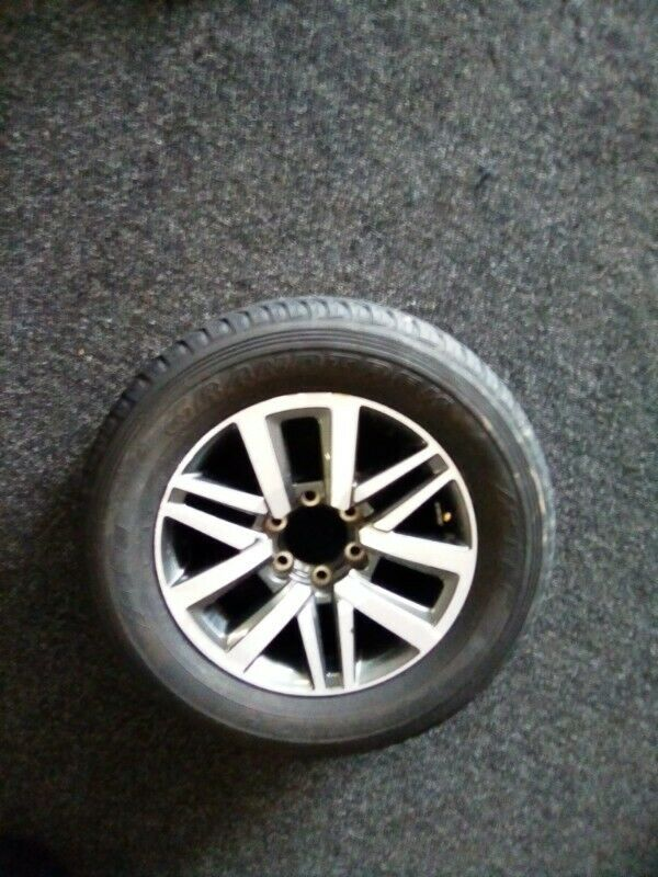 "18"" Toyota Hilux/Fortuner original mag with used 265/60/18 to use for spare R2699."
