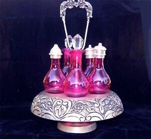Cranberry-Glass-Cruet-Set-5-Cranberry-Cruets-with-Metal-Embossed-Holder