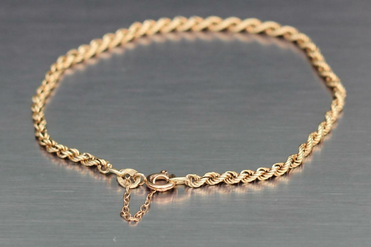 14 CT gold TWISTED CHAIN BRACELET 4.2G