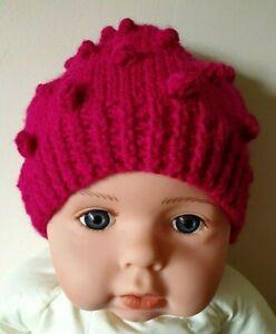 New handknitted raspberry pink popcorn stitch baby hat. 0-6 month.