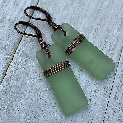 Olive green seaglass wrapped in brass color jewelry wire
