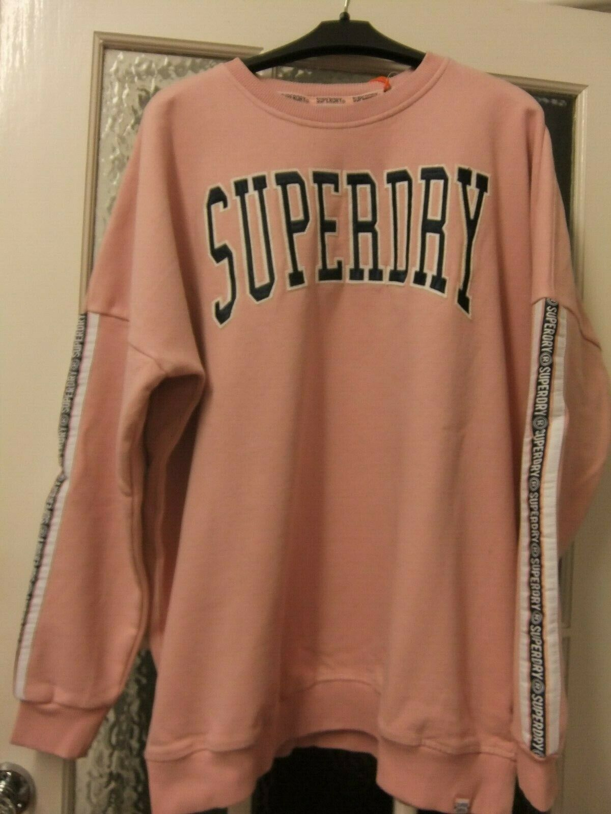 Nice pink sweatshirt to fit size 12.