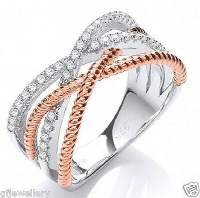 J JAZ: RHODIUM PLATED 925 SILVER CROSSOVER RING WITH 9CT ROSE GOLD ROPE DETAIL