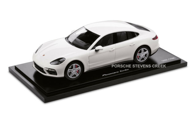 A White Porsche Panamera on a white lincoln navigator, a white bmw m3 convertible, a white dodge journey, a white chevrolet camaro, a white jeep patriot, a white toyota avalon, a white acura tl, a white hyundai genesis, a white volkswagen beetle,