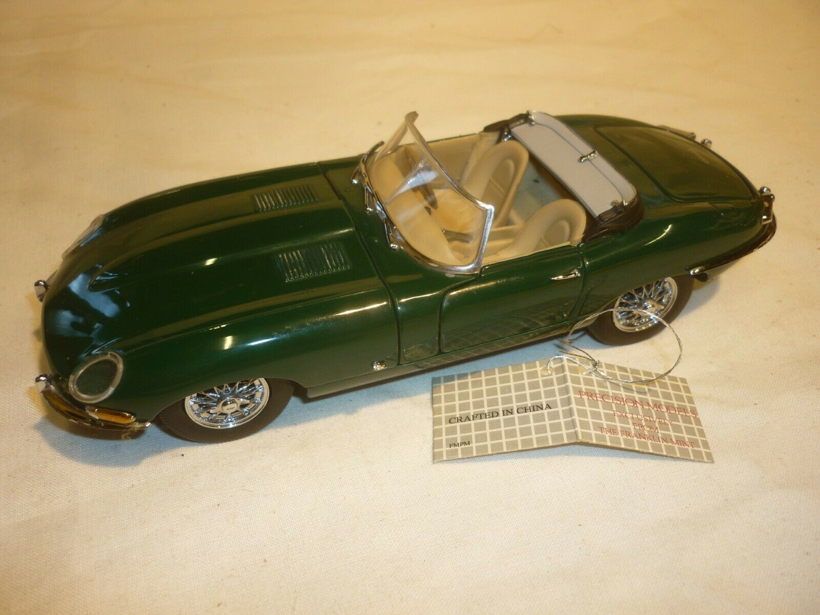 A Franklin mint of a scale model of a 1952 Jaguar xk 120 Roadster, no box