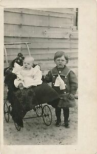 Two-Young-Children-and-Baby-Carriage-Real-Photo-Postcard-rppc