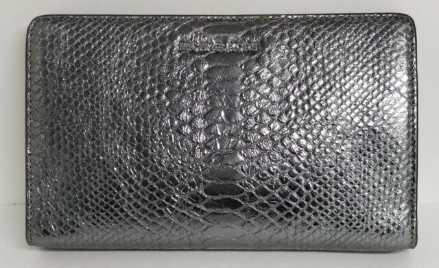 d026cfd5e1e08 Frequently bought together. Michael Kors Pewter Embossed Leather Large  Crossbody Clutch
