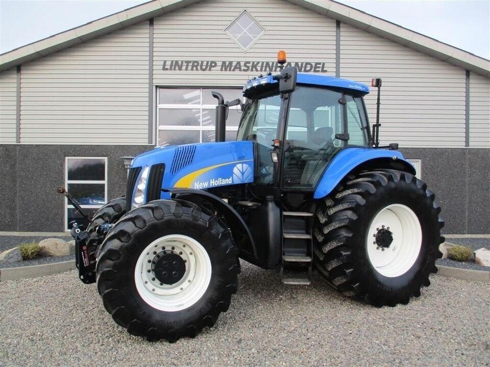 New Holland, TG285 med frontlift på, timer 8079