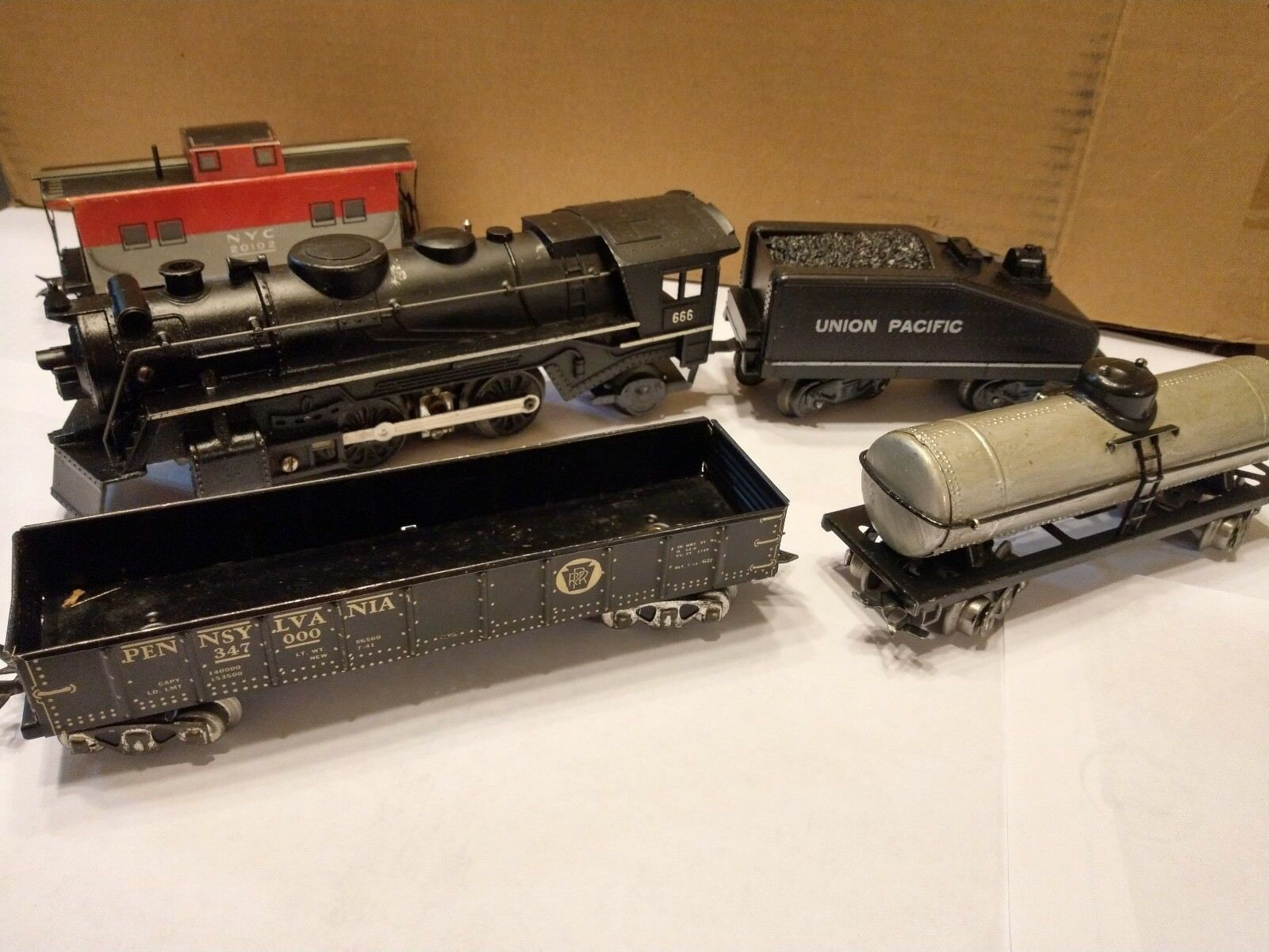 1950's Marx Train Set with 666 Steam Engine and four tin plate cars.