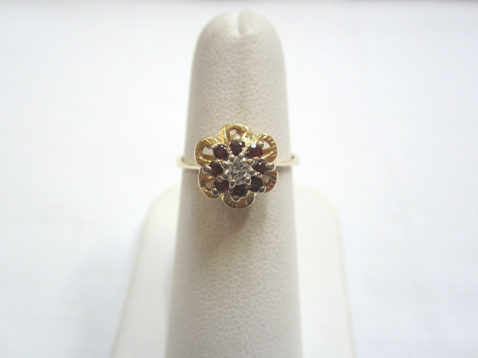 14K gold RING WITH CENTER DIAMOND SURROUNDED BY GARNET GEMSTONES