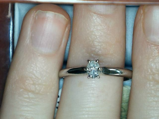 14 kt white gold .22 ct oval solitaire 130344