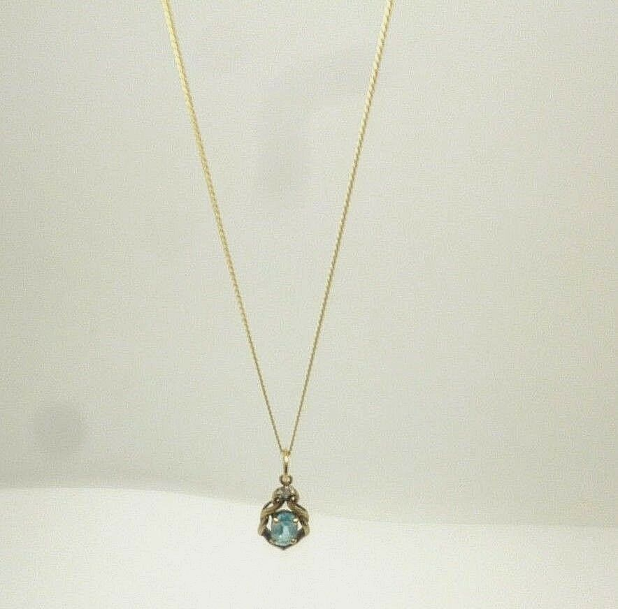 9ct yellow gold oval cut bluee topaz and diamond pendant with 18' curb chain