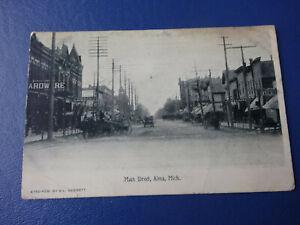 1910-Postcard-Main-Street-Alma-Michigan