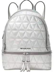 f1d978226ca6 New Michael Kors Rhea Zip Medium Backpack pyramid quilted silver ...