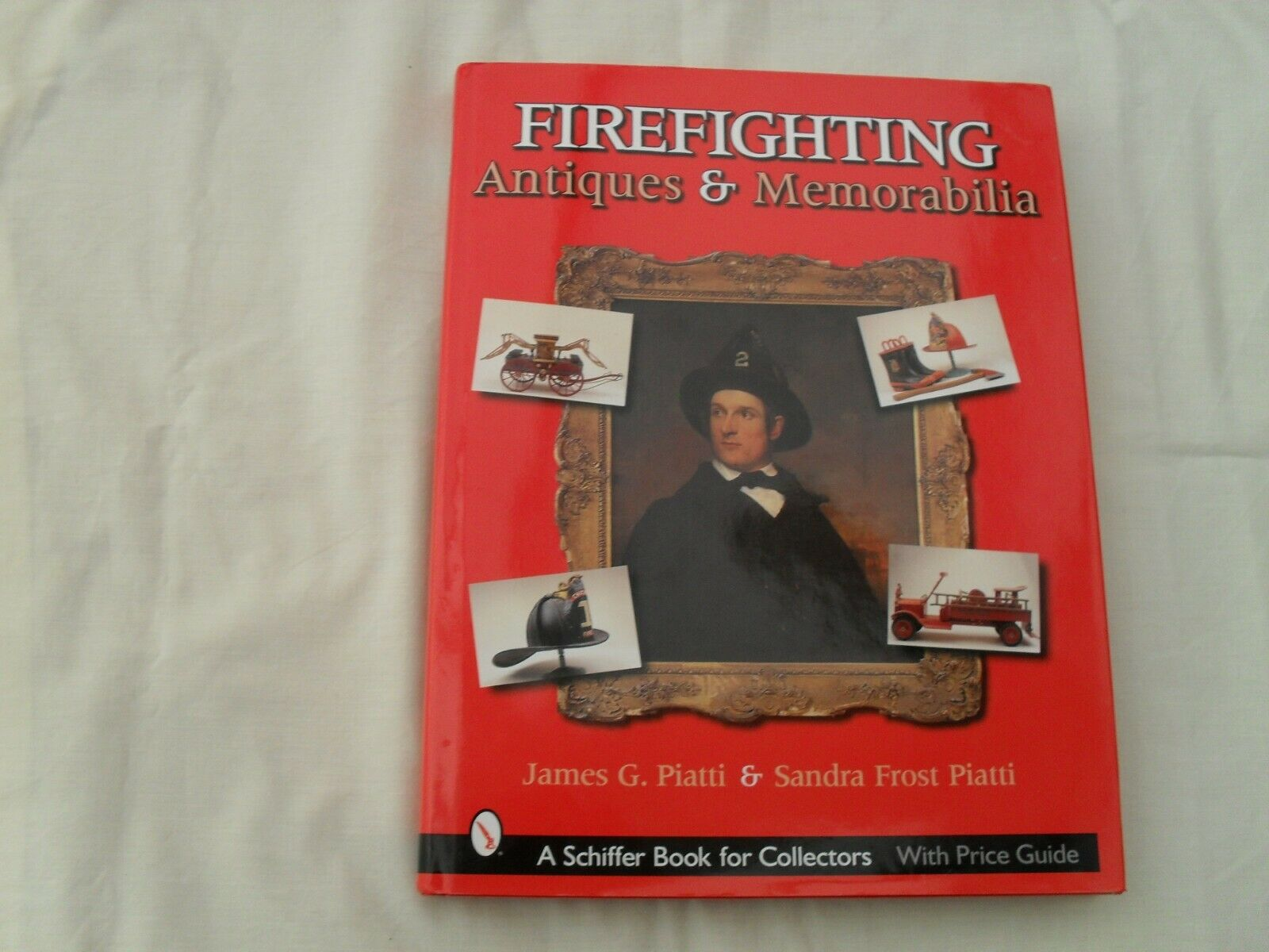 FIREFIGHTING TOYS and ANTIQUES HELMETS BADGES TOYS TRUMPETS UNIFORMS
